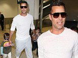 Daddy down under! Ricky Martin leads the way as he takes children for walkabout in Australian airport