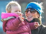 Family: Zara speaks to her brother Peter as Savannah points and smiles at her daddy on Saturday