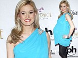 Holly Madison wore an off shoulder baby blue dress with black tights and silver high heels