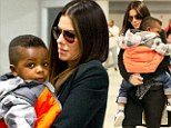 Somebody needs a nap! Sandra Bullock snuggles her sleepy son as she arrives at JFK Airport