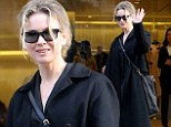 Bucking the trend! Renée Zellweger looks a dishevelled in oversized coat and sports messy hair for trip to Prada boutique in Paris during Fashion Week