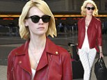 Code red! January Jones spices up her flight as she jets out wearing leather motorcycle jacket and tight white trousers