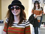 Lily Collins is in a happy mood as she walks through Los Angeles International Airport