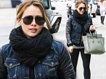 Back to reality! Hilary Duff wards off the winter chill in a chunky scarf just days after returning home from a family beach holiday