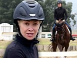 Hot to trot! Portia de Rossi dons her riding gear as she puts her horse through its paces in Los Angeles