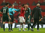 Disbelief: Nani (centre) was distraught after Cuneyt Cakir sent him off for a high challenge