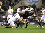 Getting to grips: Courtney Lawes and Mako Vunipola (centre) tackle Scotland's Sean Lamont