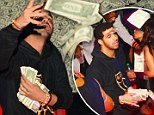 Making it rain! Drake brings cardboard box filled with $50,000 cash to strip club... and throws fistfuls of dollars in the air for the scantily-clad dancers