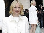 Forget the models... all eyes on me please! Naomi Watts commands attention as she shows off her long legs in a white minidress for Louis Vuitton Paris show