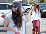 Dressed down Selena Gomez puts a freeze on the glamour as she enjoys fro-yo with pal after stunning desert video shoot