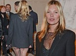 Oh derriére! Kate Moss hits a bum note as she steps out in bizarre sheer diamante embellished catsuit