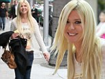Beaming Tara Reid polishes up her look with a visit to the nail salon