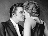 A star is born: A 21-year-old Elvis 'kiss' young fan Barbara Gray just before going on stage at the the Mosque Theatre Richmond, Virginia in June 1956