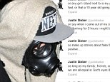 'I'm only judged by one power, and I serve him': Justin Bieber slams critics in Twitter tirade before heading out on the town in London in bizarre gas mask