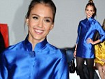 Someone's forgotten their skirt! Jessica Alba arrives at Paris fashion show in just a sexy electric blue shirt, tights and heels