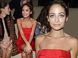 Disappearing act: Nicole Richie can't hide her worryingly thin frame as she swans to front row at Valentino show