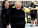 Yet another Katherine Webb fan! Louie Anderson sweeps his Splash co-star into his arms as the pair practise their dives