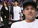 Khloe Kardashian enjoyed an evening out at a basketball game with brother Rob who is currently attempting to slim down