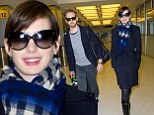 Post-Oscar holiday? Newlyweds Anne Hathaway and Adam Shulman bundle up as they land in the Big Apple