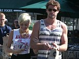 'I didn't call off my wedding!': Miley Cyrus denies that her engagement to Liam Hemsworth is over after it emerges that couple are in a 'rough patch'