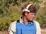 Prince Harry is shown around a minefield in Mozambique in 2010