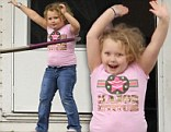 Going round in circles! Honey Boo Boo energetically shows off her hula hooping skills on her front porch