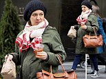 There's no missing that bump! Maya Rudolph looks heavily pregnant under her winter layers