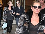 She just can't cover up! Kate Moss steps out in sheer blouse a day after flashing her bottom in see-through catsuit