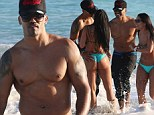 Shirtless Shemar Moore displays his ripped gym body and kisses bikini babe on Miami Beach