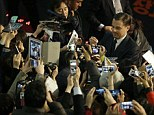 Leonardo DiCaprio met hundreds of enthusiastic fans and posed for photos and signed autographs in South Korea on Thursday