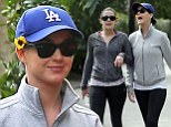 Flower power: Katy Perry sports a bright yellow flower behind her ear to brighten up her workout outfit while hiking in Los Angeles on Wednesday