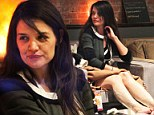 Putting her feet up: Make-up free Katie Holmes enjoys a pampering session as she receives a pedicure and wax