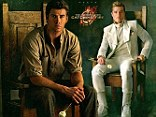 The Hunger Games hunks are back! Liam Hemsworth and Josh Hutcherson compete for Katniss in new Catching Fire posters