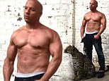 Shirtless Vin Diesel flexes his grrr-eat muscles as he poses with fierce feline companion