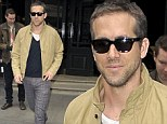 Retro and so effortlessly cool: Ryan Reynolds cuts a casual but stylish figure stepping out in checked trousers, Converse and Ray Bans