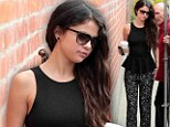 Justin who? Selena Gomez is the picture of elegance as she throws herself into work following her recent breakup