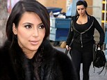 'She thought she was having a miscarriage': Pregnant Kim Kardashian 'rushed to the doctors in tears... before being told to STOP exercising'