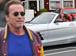 Petrol head! Arnold Schwarzenegger wears sport jacket and round sunglasses to take his Mercedes-Benz SLS AMG for a spin