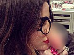 How ride! Khloe Kardashian poses with a pair of joke glasses with a rubber penis over her nose as she fools around with sister Kendall Jenner