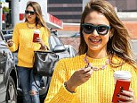 Showing off her sunny disposition with her style: Jessica Alba sports bright yellow jumper and ripped jeans for casually chic look