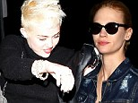 January Jones stays mum when quizzed over Liam Hemsworth flirtation... as Miley spends another night without her fiance
