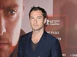 Sneak peek: Readers can see a short clip of Side Effects starring Jude Law, pictured at the Paris premiere on Thursday night and Rooney Mara