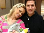 'So happy': New mother Holly Madison shared this picture of herself and partner Pasquale Rotella on Friday