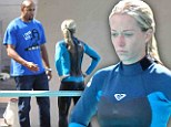 Look who's giving pointers! Kendra Wilkinson gets coached by husband Hank Baskett during diving practice on Splash