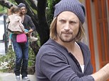 Father and daughter bonding: Gabriel Aubry clings tight to little Nahla as they chat animatedly on the way to school