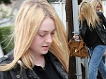 Casual Friday: Make-up free Dakota Fanning wears rolled-up baggy jeans as she treats her mother to a manicure