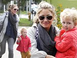 Mummy's growing girl: Rebecca Gayheart keeps it casual as she carries her birthday princess
