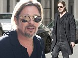 The $35 million dollar man! Brad Pitt takes a leisurely stroll through Paris after his massive 2012 pay packet is revealed