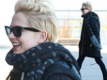 Taking it all in her stride! Smiling Michelle Williams maintains her happy demeanour as she continues to move on from split with Jason Segel
