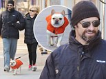 Lucky pooch: Hugh Jackman dressed his dog in a bright orange vest